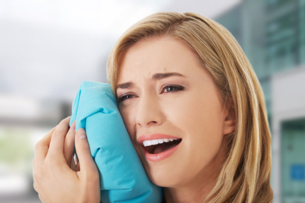Woman having tooth ache